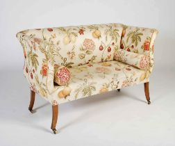 A late 19th/ early 20th century mahogany sofa in Regency style, the later fruit and flower