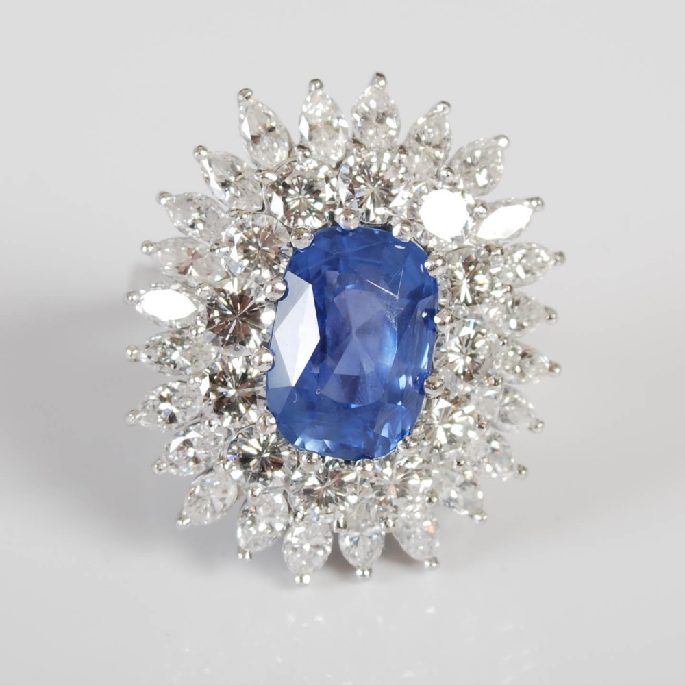 A white metal sapphire and diamond cluster ring, 20th century, centred with a rectangular cushion - Image 5 of 7