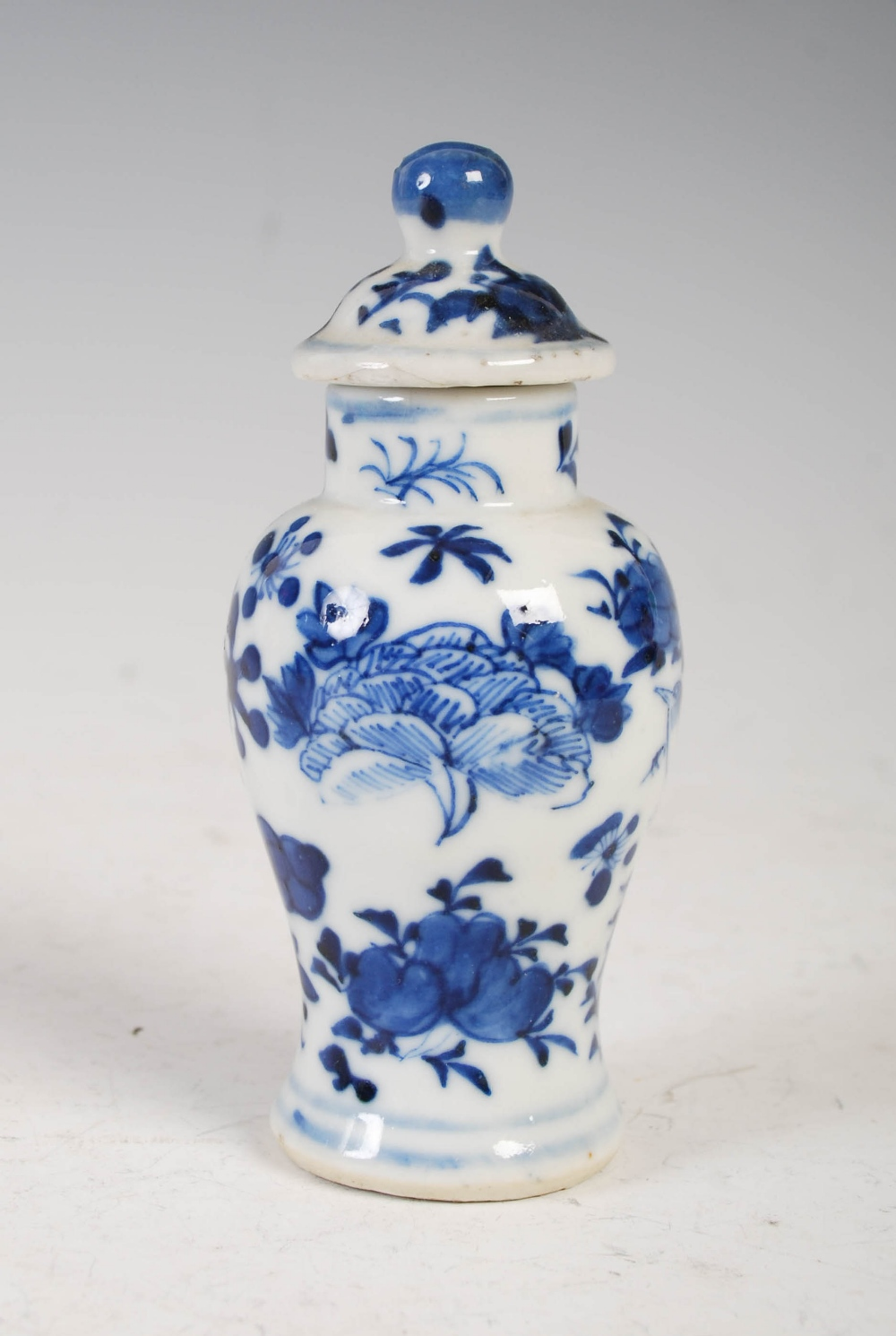 A miniature Chinese blue and white porcelain jar and cover, late Qing Dynasty, decorated with