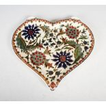 A late 19th/ early 20th century Zsolnay Pecs pottery heart-shaped tray, decorated with a Persian