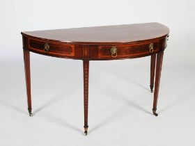 A 19th century mahogany and marquetry inlaid demi lune console table, the shaped top above a