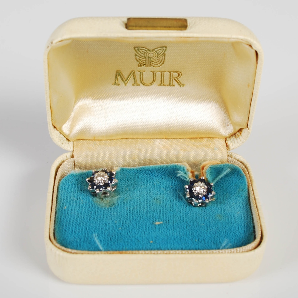 A pair of white metal sapphire and diamond set cluster earrings, circa 1970, each centred with a - Image 3 of 3