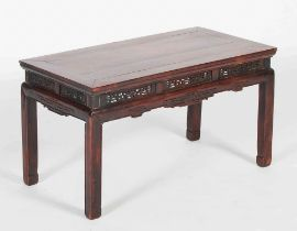 A Chinese dark wood Kang table, Qing Dynasty, the rectangular panelled top above a frieze set with