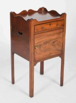 A 19th century mahogany bedside locker in George III style, the rectangular top with shaped three