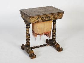 A 19th century Chinese export lacquer work table, the hinged rectangular top decorated with