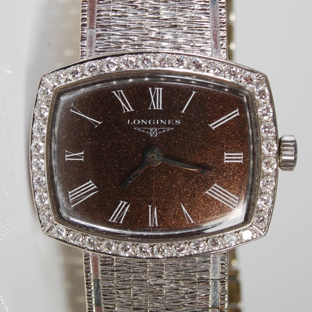 An 18ct gold and diamond set Longines ladies wristwatch, import hallmarks for London, 1968, B&Co., - Image 7 of 8