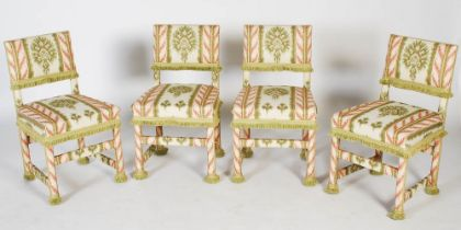 A set of four upholstered side chairs, 20th century, with fringed detail, 81cm high.