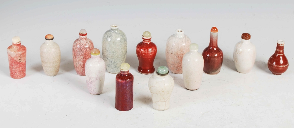 A collection of thirteen Chinese porcelain monochrome snuff bottles, Qing Dynasty and later, to