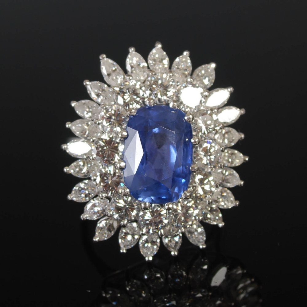 A white metal sapphire and diamond cluster ring, 20th century, centred with a rectangular cushion - Image 4 of 7