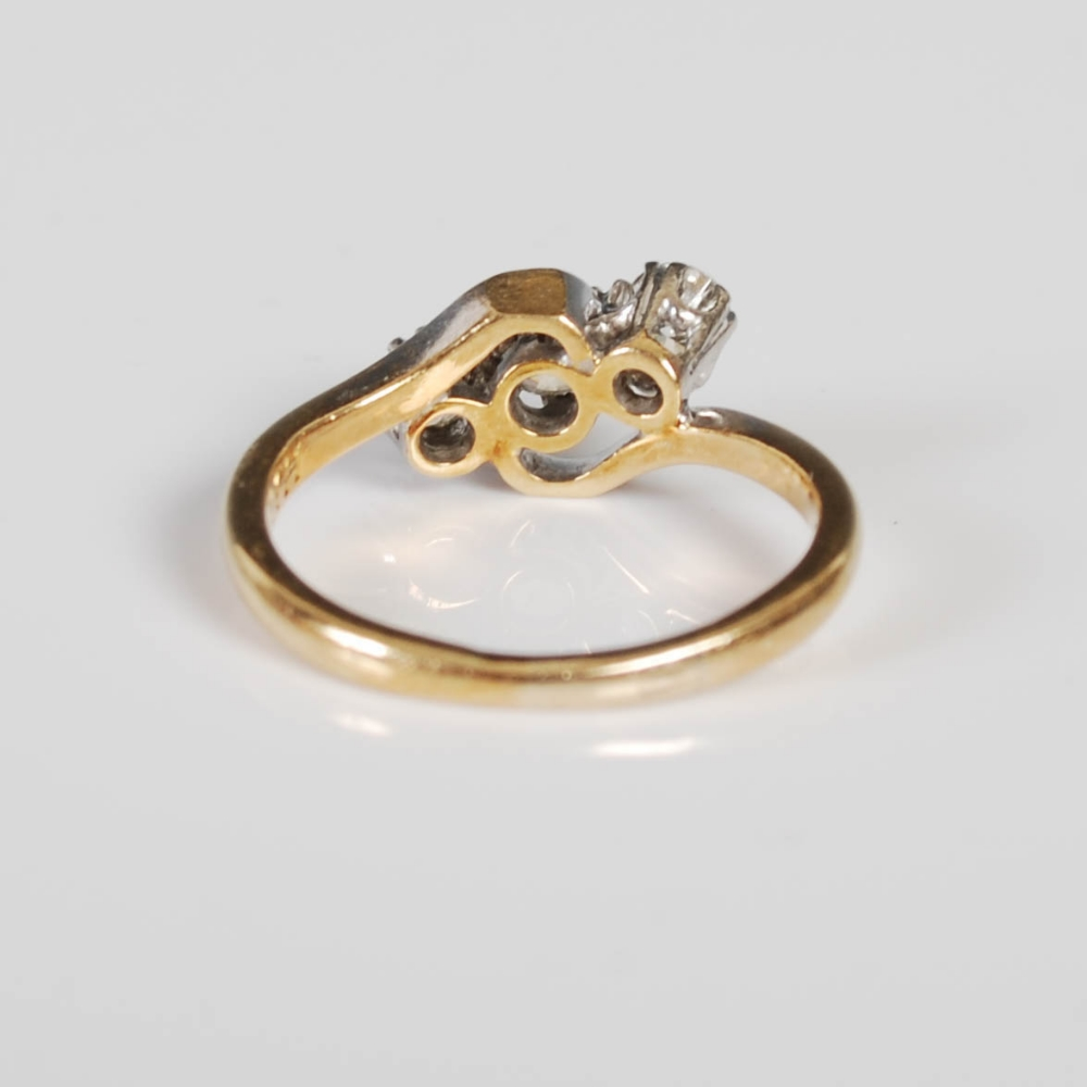 A yellow and white metal three stone diamond ring, mid 20th century, set with a single round - Image 3 of 6