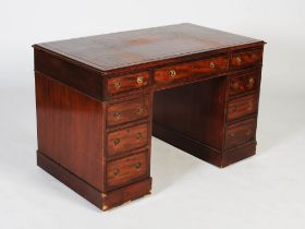A 19th century mahogany pedestal desk, the rectangular top with claret coloured skiver above a