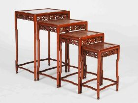 A quarteto of four Chinese occasional tables, 20th century, the rectangular panelled tops above