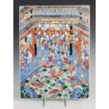 A Chinese famille rose rectangular shaped porcelain panel, Qing Dynasty, decorated with figures on a