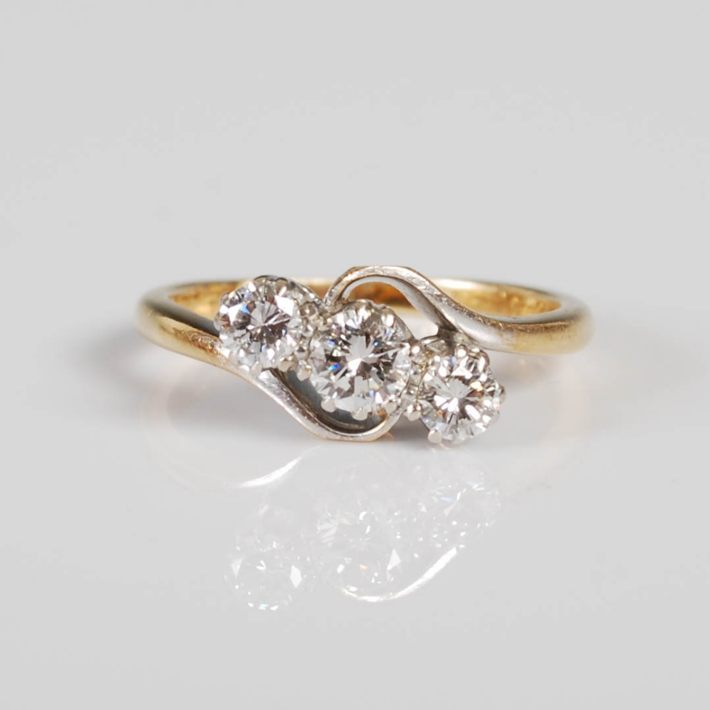 A yellow and white metal three stone diamond ring, mid 20th century, set with a single round - Image 4 of 6