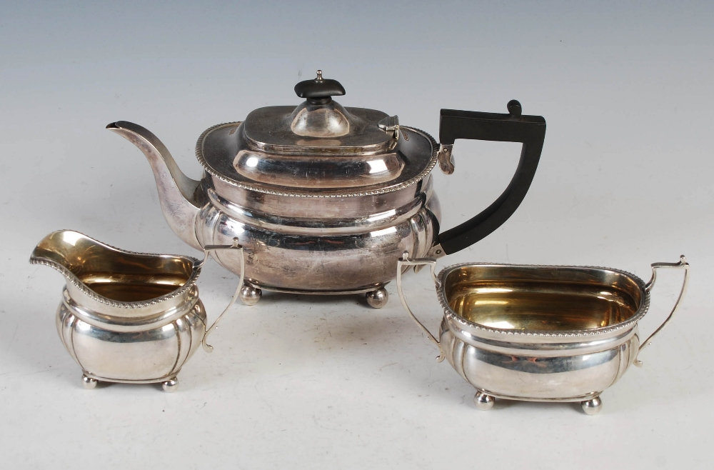A George VI three piece silver tea set, London, 1939, makers mark of C&Co., oval shaped with - Image 2 of 8