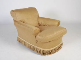 A late 19th century mahogany armchair in the style of Howard & Sons, the upholstered back and arms