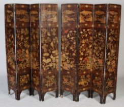 A Chinese lacquer eight-fold screen, Qing Dynasty, with incised decoration of birds and flowers to