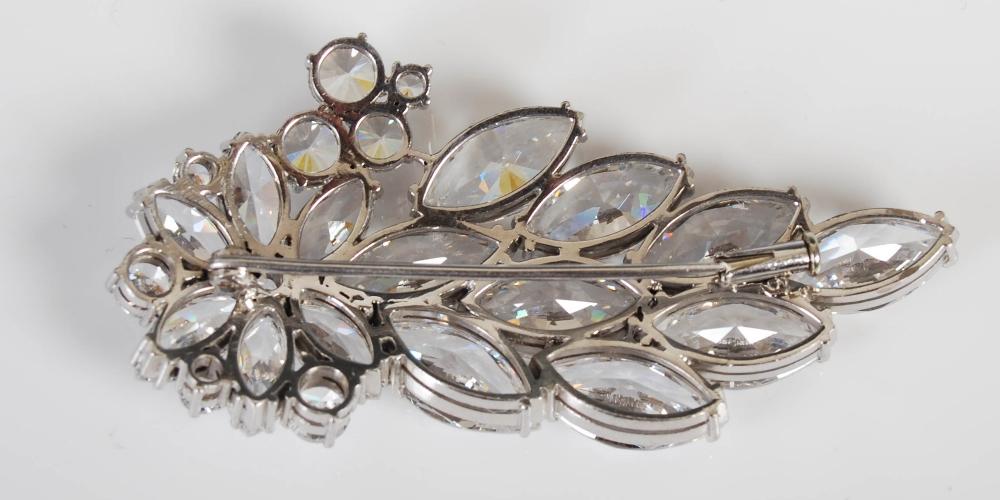 A white metal yttrium aluminium garnet set spray brooch, mid/ late 20th century, set with marquise - Image 5 of 5