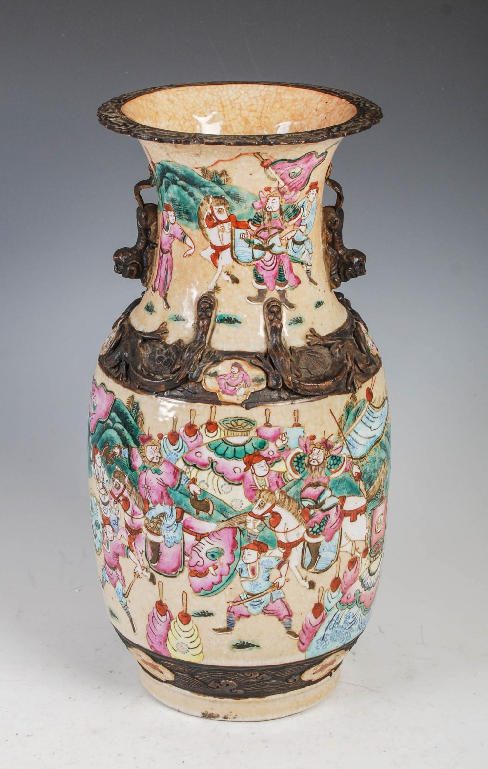 A Chinese porcelain crackle glazed famille rose vase, Qing Dynasty, decorated with warriors, incised