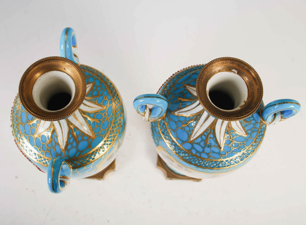 A pair of 19th century French porcelain ormolu mounted twin handled urns, decorated with hand - Image 3 of 6