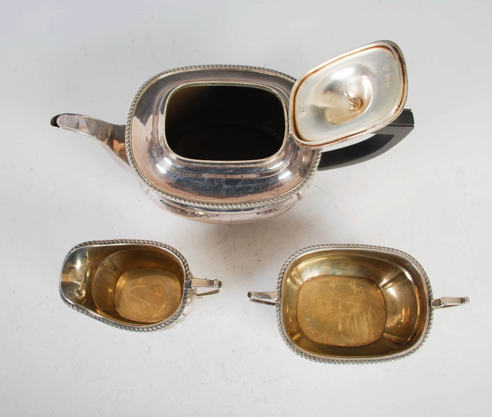 A George VI three piece silver tea set, London, 1939, makers mark of C&Co., oval shaped with - Image 3 of 8