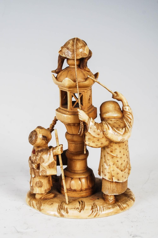 A Japanese ivory okimono of monkey lantern lighter, boy and dog, Meiji Period, signed, 8cm high. - Image 2 of 3