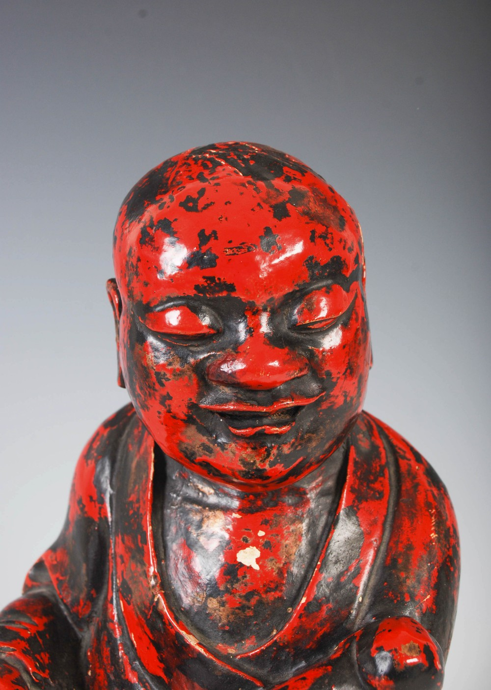 A Chinese carved camphor wood and red lacquered figure of a boy, Qing Dynasty, carved holding a ruyi - Image 3 of 6