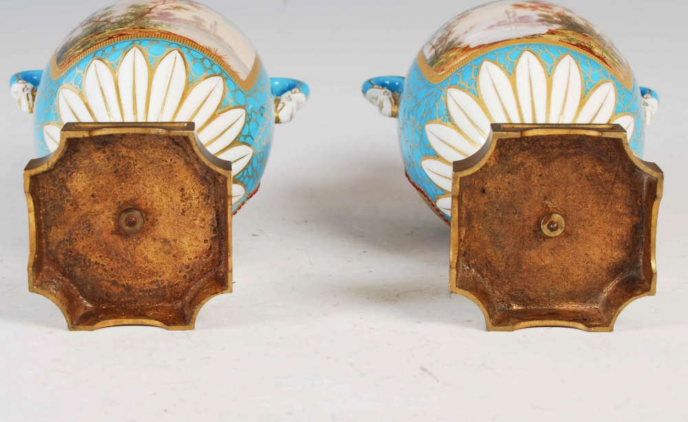A pair of 19th century French porcelain ormolu mounted twin handled urns, decorated with hand - Image 4 of 6