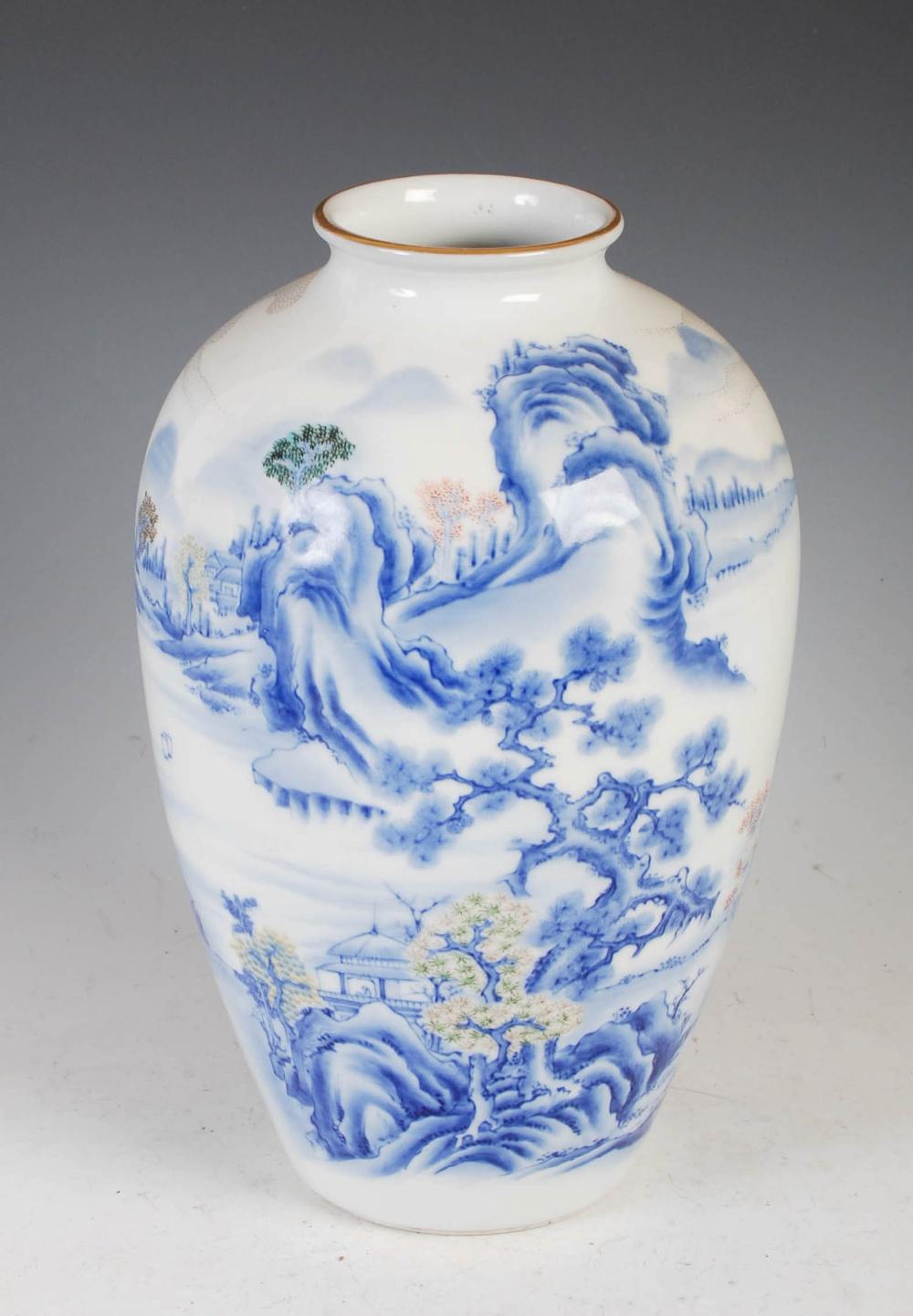 A Japanese Fukagawa porcelain vase, late Meiji/ Taisho Period, decorated with pavilion on a
