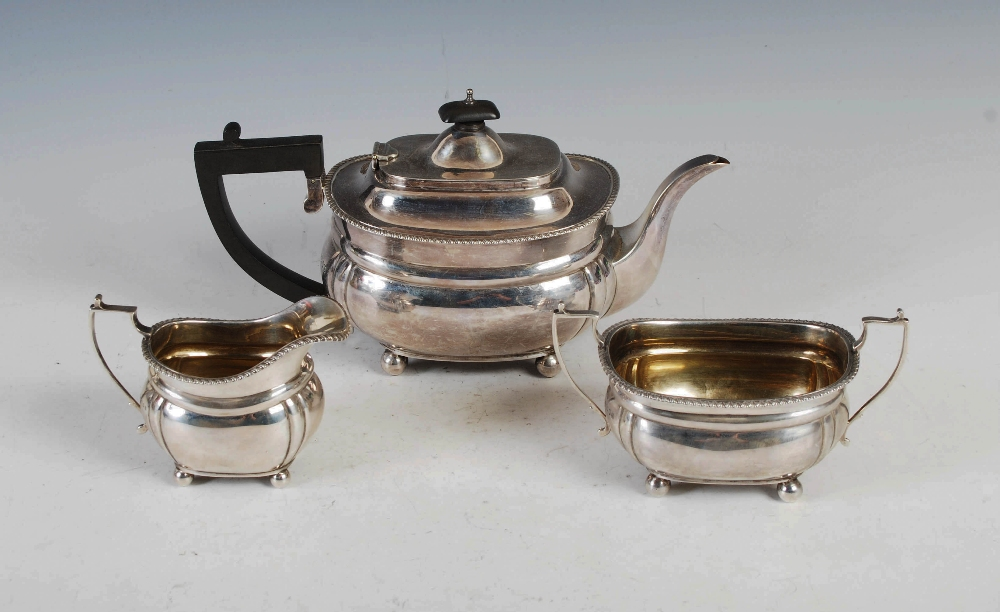 A George VI three piece silver tea set, London, 1939, makers mark of C&Co., oval shaped with