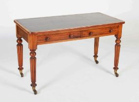 A 19th century mahogany library table in the manner of Gillows, the rectangular top with green and