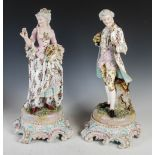 A pair of late 19th century Dresden porcelain figures, the male modelled standing holding a rose