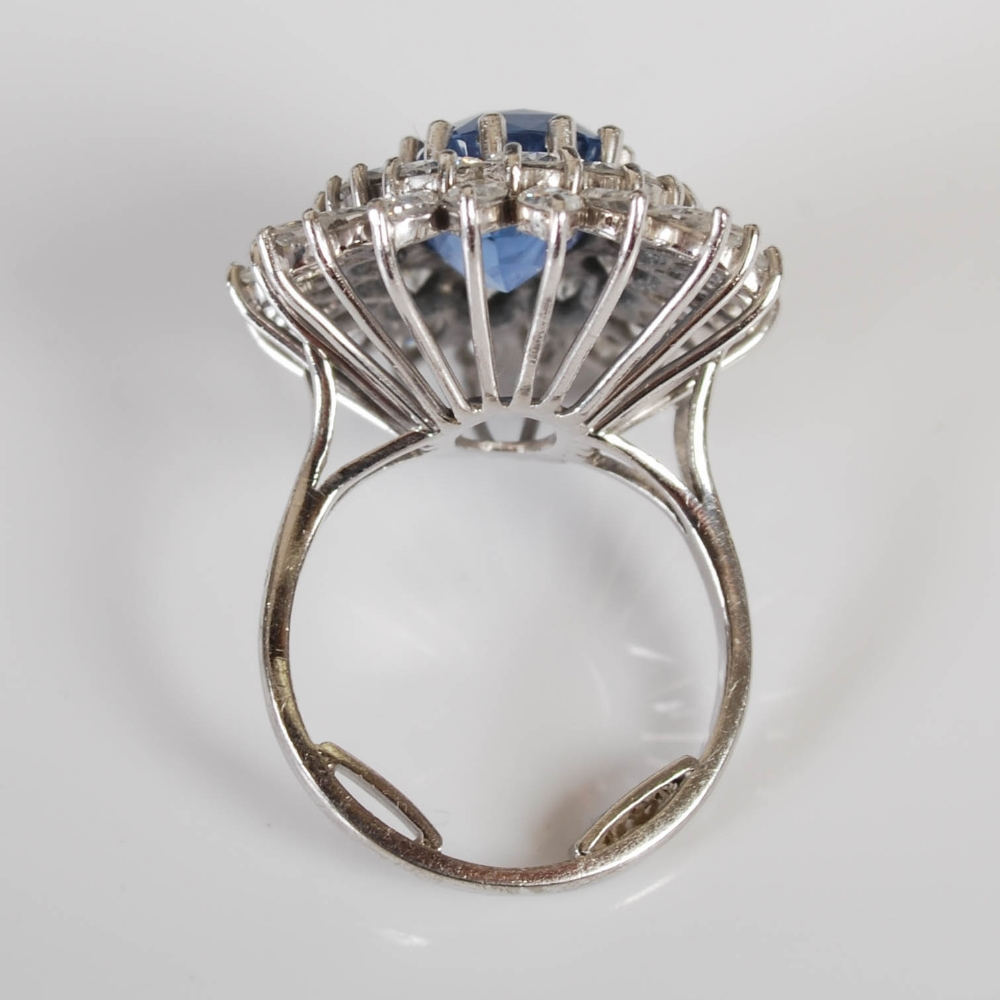 A white metal sapphire and diamond cluster ring, 20th century, centred with a rectangular cushion - Image 7 of 7