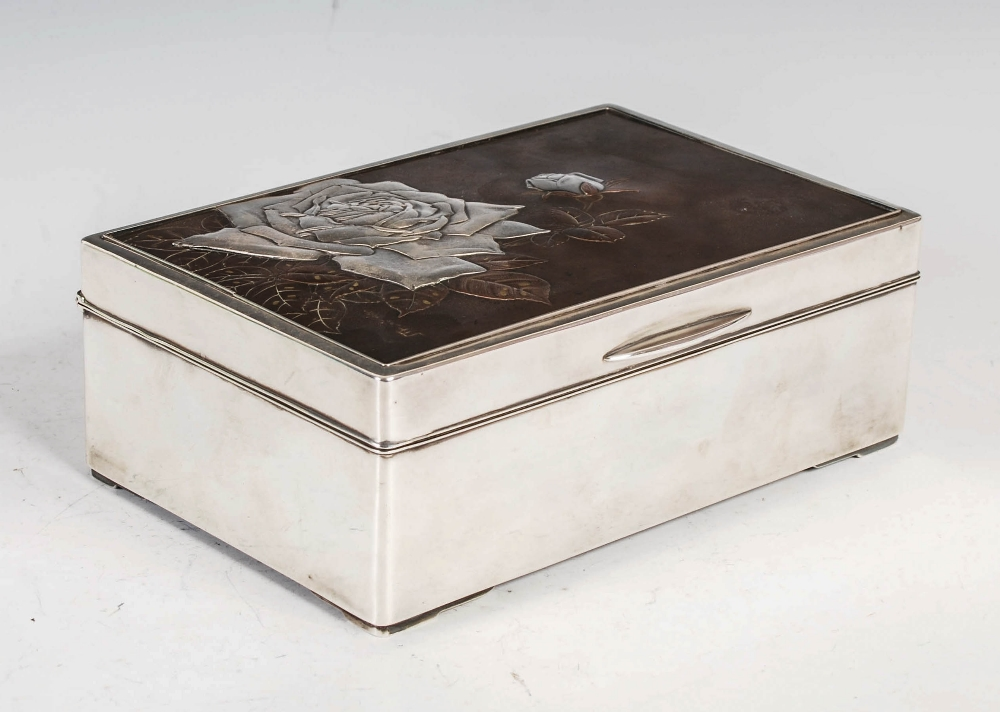 A Japanese silver rectangular shaped box, late 19th/ early 20th century, the hinged cover with