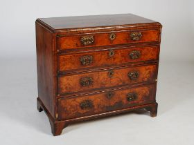 An 18th century walnut chest, the rectangular top with chevron banded border within a moulded
