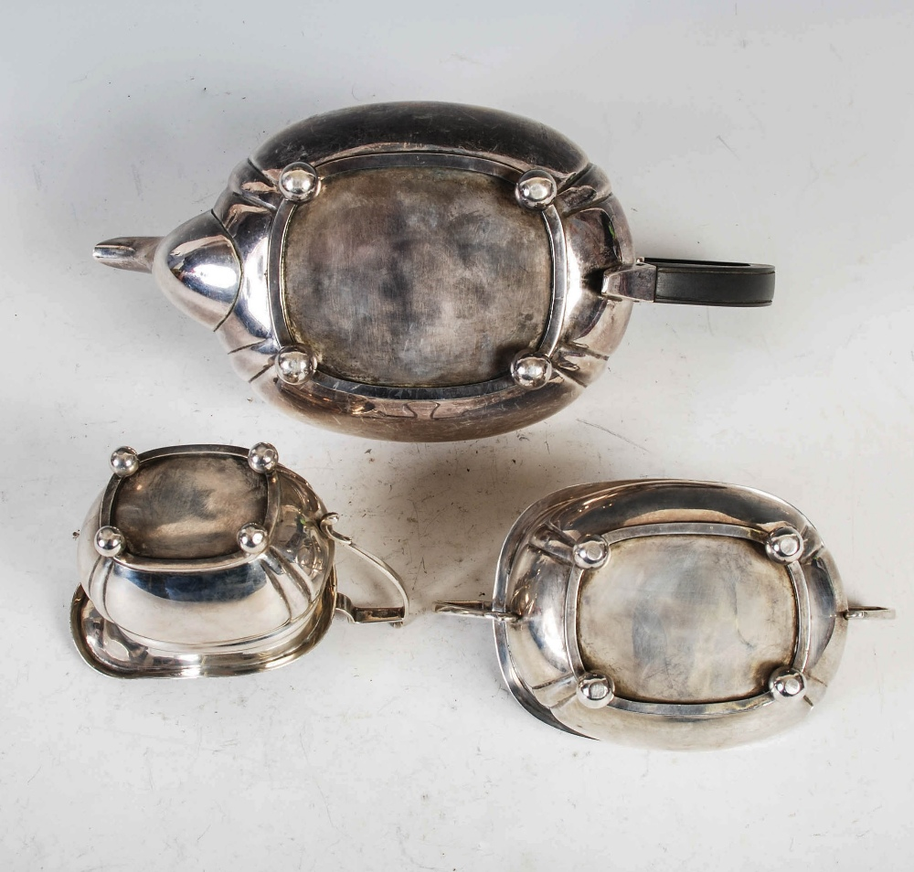 A George VI three piece silver tea set, London, 1939, makers mark of C&Co., oval shaped with - Image 4 of 8