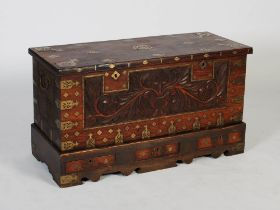 A 19th century Anglo-Indian brass bound chest on stand, the hinged rectangular top inlaid with