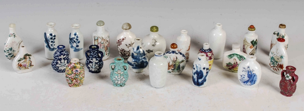 A collection of twenty four Chinese porcelain snuff bottles, Qing Dynasty and later, various