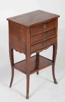 A late 19th century French kingwood occasional table, the shaped rectangular top above three shallow