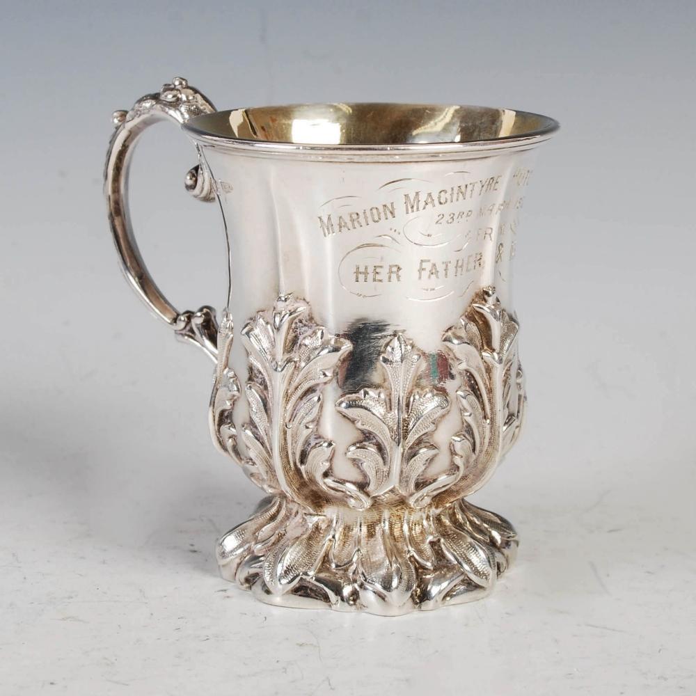 An Edwardian silver gilt Christening mug, Sheffield, 1902, makers mark of Walker & Hall, embossed