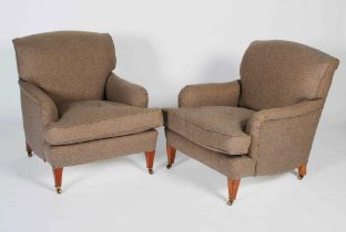A pair of mahogany club armchairs in the style of Howard & Sons, the back, arms and loose cushion