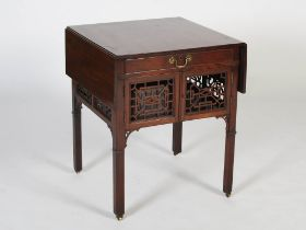 A George III supper table of Chippendale design, the rectangular top with twin drop leaves over a