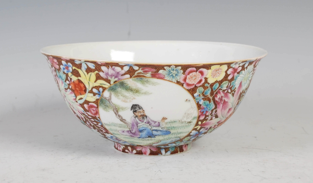 A Chinese porcelain famille rose millefleurs footed bowl, Qing Dynasty, decorated with three