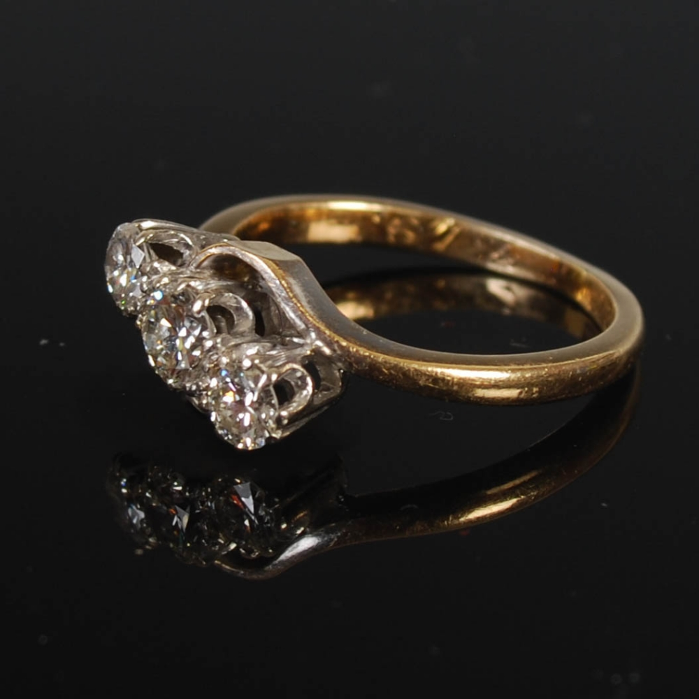 A yellow and white metal three stone diamond ring, mid 20th century, set with a single round - Image 5 of 6