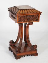A 19th century Anglo-Indian rosewood teapoy, the square sarcophagus shaped top with hinged cover