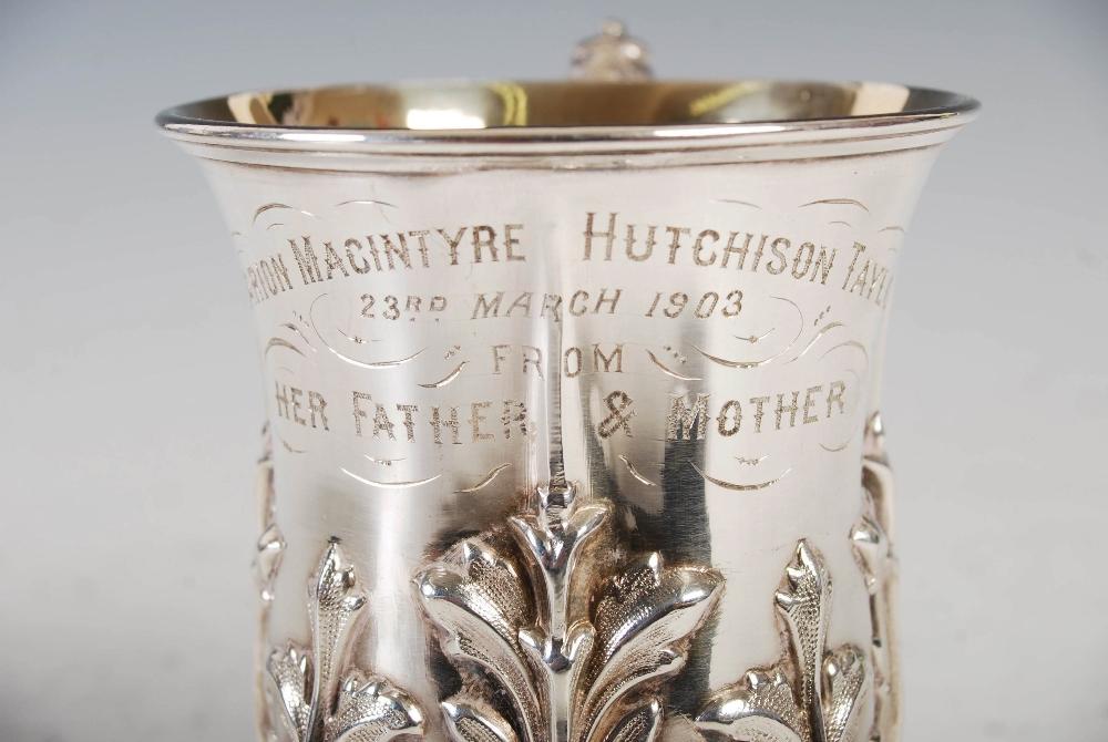 An Edwardian silver gilt Christening mug, Sheffield, 1902, makers mark of Walker & Hall, embossed - Image 4 of 7