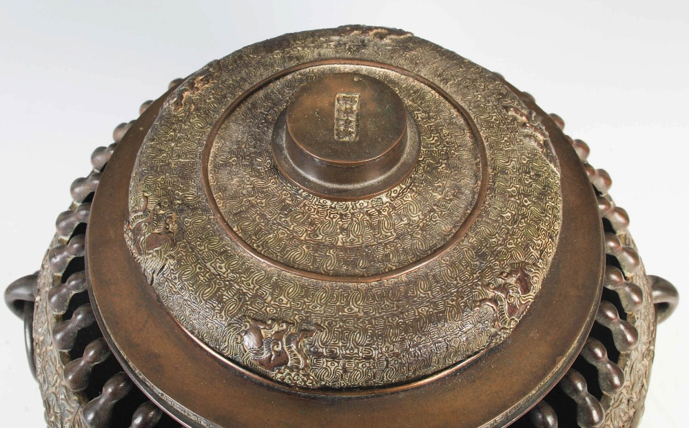 A Chinese bronze twin handled censer and cover, Qing Dynasty, the oviform body with pierced double - Image 3 of 6