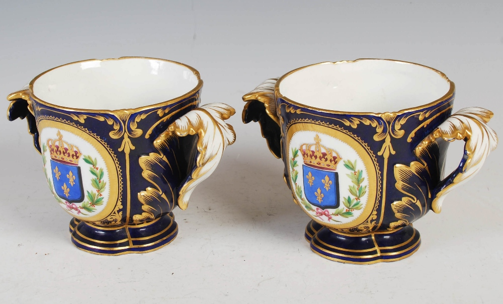 A pair of Sevres porcelain blue ground twin handled jardinieres, decorated with male and female - Image 2 of 7