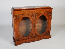 A Victorian walnut and gilt metal mounted credenza, the rectangular top and plain frieze above two
