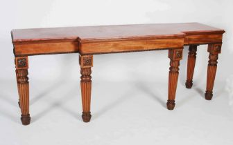 A 19th century mahogany breakfront console table, the faux marble top above a plain frieze with